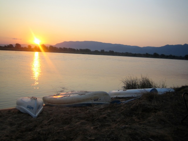 Canoes at sunset on the Zambezi river. Ready for another day.